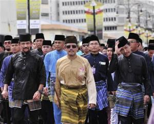 Brunei's Sultan Hassanal Bolkiah, his brothers Prince Mohamed and Prince Jefri, lead a parade to commemorate Prophet Muhammad's birthday in Bandar Seri Begawan