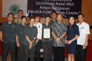 Aston Denpasar Hotel & Convention Center General Manager Irmansjah Mahdewa, receiving the hotel Halal certification from the MUI (Top) and a group picture of the hotel's senior staff marking the occasion. 'Halal Certification' - means the kitchen, food preparations, supply chains and menus of the hotel have all been inspected and certified to confirm to strict requirements for compliance with Islamic dietary traditions.