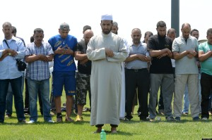 Muslim workers pray after colleagues wer