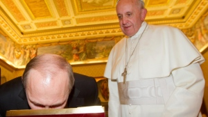 Russian President Vladimir Putin bends to kiss an icon of the Madonna as Pope Francis looks at him on the occasion of their private audience at the Vatican, Monday, Nov. 25, 2013. (AP / Claudio Peri) Read more: http://www.ctvnews.ca/world/putin-meets-both-pope-and-old-friend-berlusconi-on-visit-to-rome-1.1559723#ixzz2pJZExRGG