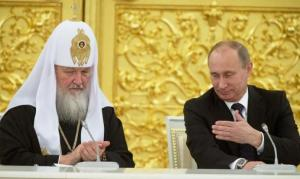 Russia's President Vladimir Putin (R) and Patriarch of Moscow and All Russia Kirill attend a meeting with Russian Orthodox church bishops in Moscow February 1, 2013. Photo: REUTERS/Sergei Gunyeev