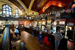 Bar at O'Neills pub, pictured in a former Presbyterian church in Muswell Hill, north London, on January 16, 2014.  Photo: AFP / Leon Neal