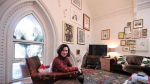 Rachel Chudley poses for a photo in the living room of her apartment, which has been converted from a church in east London, on January 16, 2014. Photo; AFP/Carl Court