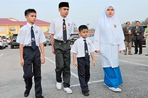 Staying strong: Siblings (from left) Adam, Ammar, Ariff and Aishah seen together as they start their school sessions in Kelantan in early February. -Photo: Bernama