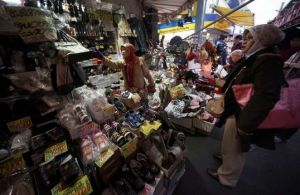 Foreign Muslim visitors shop at a store at Asakusa district in Tokyo. Photo: AP