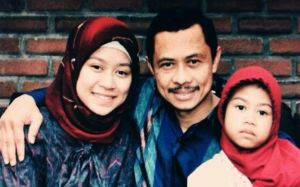 Ali with his two daughters Maryam (left) and Malika.